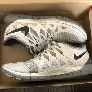 Women's Nike grey and white running shoes size 11